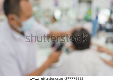 blur image of people at haircut shop for background usage.