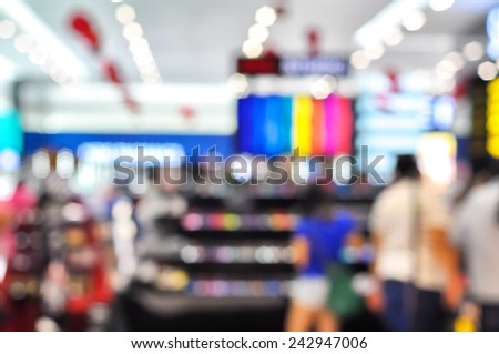 Blur image of people at make up shop with bokeh - stock photo