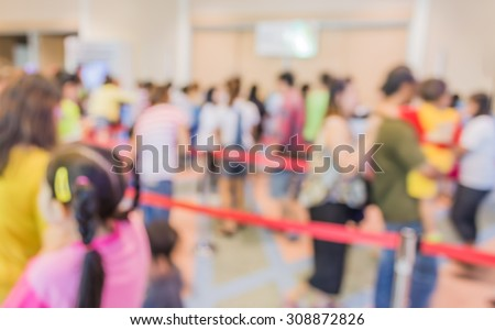 blur image of people in queue in front of exhibition gate. - stock photo