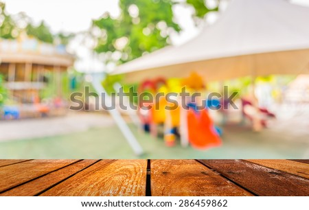 blur image of roundabout in theme park for background usage. - stock photo
