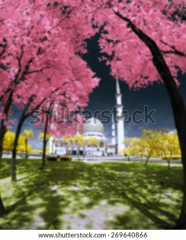Blur Image Of Shah Alam Mosque in infared (The beautiful Sultan Salahuddin Abdul Aziz Shah Mosque)  - stock photo