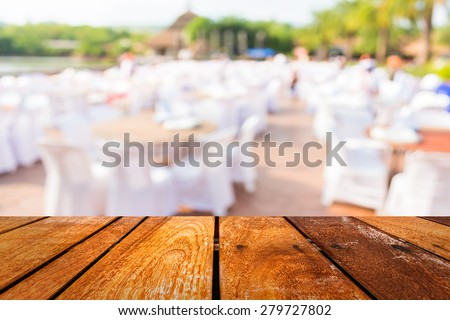 blur image of Tables and decoration prepared for an outdoor party for background usage. - stock photo