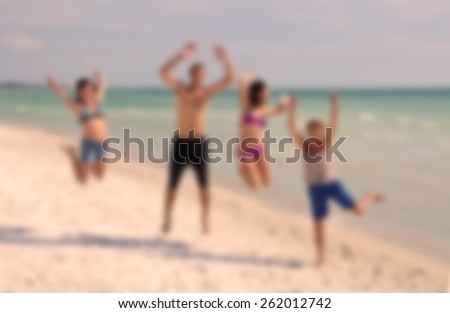 Blur Image of Teenagers Jumping on the Beach during Spring Break for background usage  - stock photo