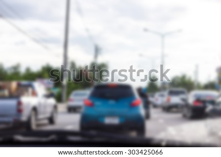 Blur image of the dirty windshield on traffic jam day. - stock photo