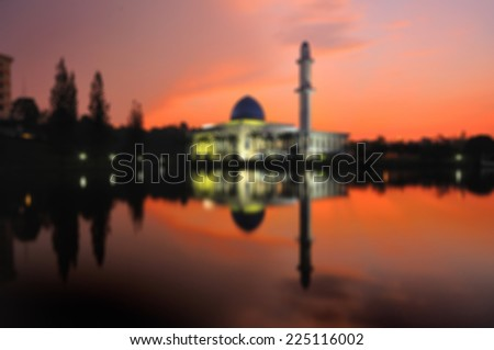 Blur image of Uniten mosque or Blue Mosque during sunrise - stock photo
