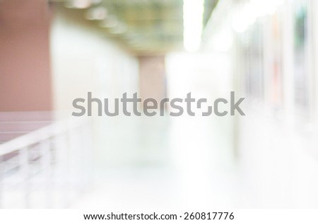 Blur inside office building with bokeh light background, interior and business background - stock photo
