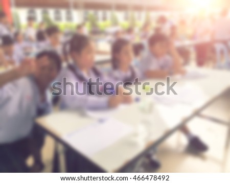 Blur kids and teacher in the school for background usage.