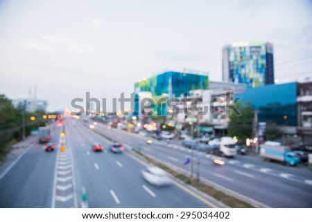 Blur light car trails on the modern building background - stock photo