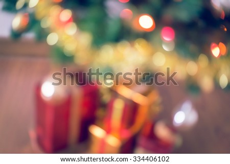 blur light celebration on christmas tree with gift box in living room - stock photo
