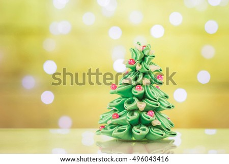 Blur light celebration on christmas tree with wall background.