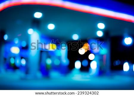 Blur light of petrol station - stock photo