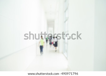 Blur modern first floor hall background. airport, clinic clinical showroom merge inside blurry corridor clinical light health healthcare glow backdrop blue center dynamic finance school atrium public