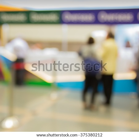Blur motion of people and receptionist at seminar registration counter