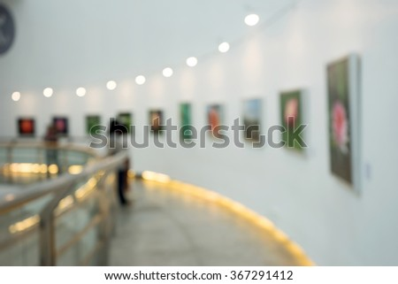 blur museum people looking show picture on the wall - stock photo