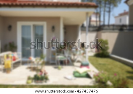 blur new house with a garden in a rural area - stock photo