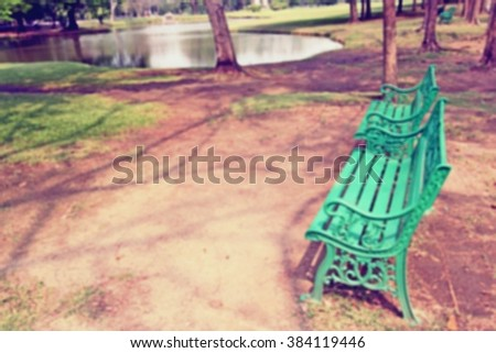 blur of Bench under the tree in the Gardens, vintage style - stock photo
