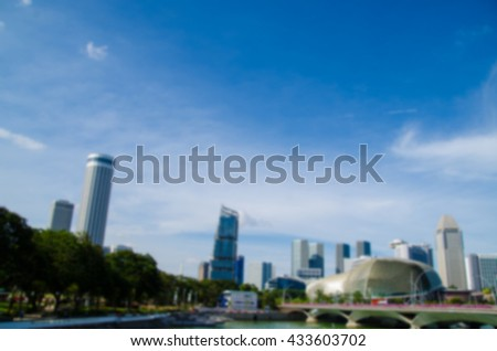 blur of blue sky and business building with the river