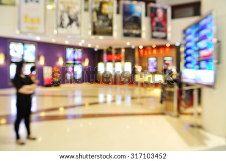 Blur of Defocus Background of People Waiting in Movie or Cinema Complex Lounge - stock photo