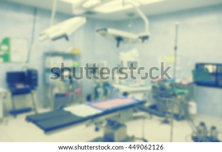 Blur of equipment and medical devices in modern operating room take with art lighting and blue filter.Operating room ready for operation - stock photo