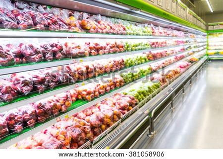 Blur of fresh fruits on shelf in supermarket.For healthy concept - stock photo