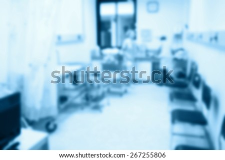 blur of nurses station in a hospital. - stock photo