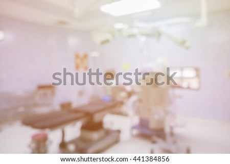 Blur of operating room,equipment and medical devices in modern operating room take with art lighting and blue filter,a room in a hospital specially equipped for surgical operations - stock photo