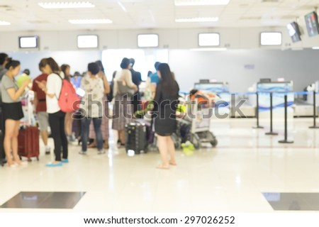 Blur of passenger waiting for check in at airline counter in the airport.  - stock photo