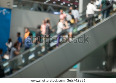 blur of people that using escalator at shopping mall