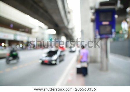Blur or Defocus Background of People Waiting for Taxi in Asian Metropolitan City. - stock photo