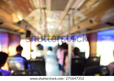 Blur or Defocus image of People in a Bus as Background - stock photo