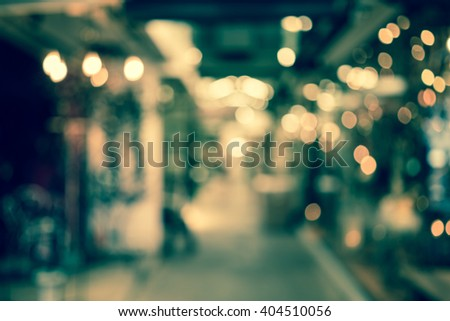 Blur or Defocus image of walk way in market or shopping mall for use as Background - stock photo