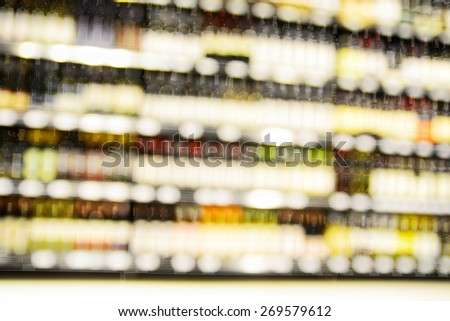 Blur or Defocus image of Wine on the Shelf of Liquor Store - stock photo