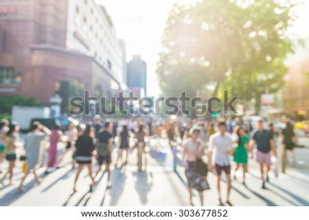 Blur people at orchard road in singapore - sunflare effect filter - stock photo