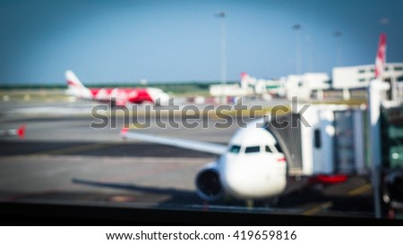 Blur Photo Of Aircraft At Boarding Departure At International Airport In Morning.