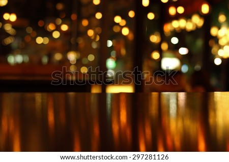 blur reflection light on table in bar and restaurant at night - stock photo