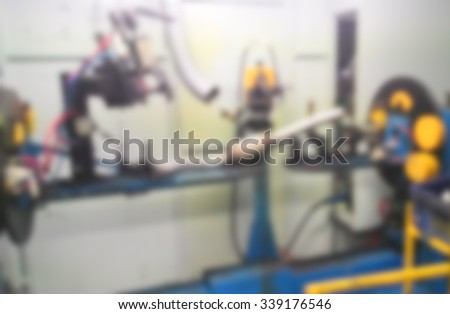 Blur rotary welding machine for weld intake muffler in car component factory, Automobile factory, Automobile industrial. - stock photo