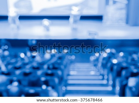 blur row of  empty blue  auditorium or theater seat