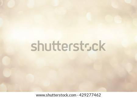 Blur shining brighten soft cream gold wallpaper with circle lantern:abstract blurred background in light toned.blurry bulbs ball motion of golden colored backdrop.blurry sparkle glitter concept.  - stock photo