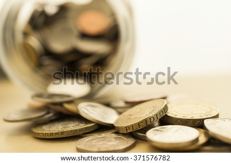Blur stack of coins background money saving concept - stock photo