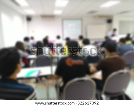 Blur student during study or lecture and quiz or exams from teacher or professor in classroom with notebook in master degree of industrial management programs or MBA at Thailand university  - stock photo