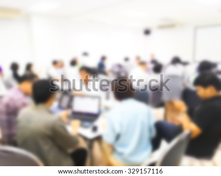 Blur student during study or lecture and quiz or exams from teacher or professor in classroom with notebook in master degree of industrial management programs or MBA class. study concept.  - stock photo