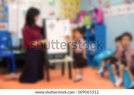 blur students and teacher in the classroom for background usage - stock photo