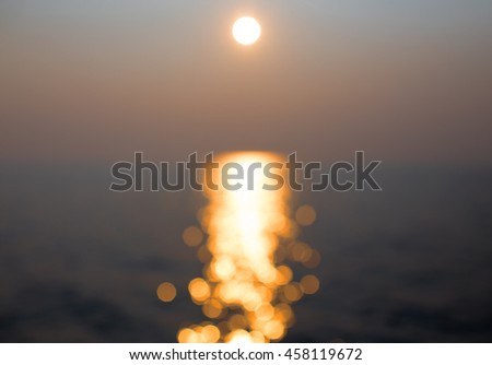 blur sunlight on the water. sunset with bokeh. sunlight and wave. abstract background - stock photo