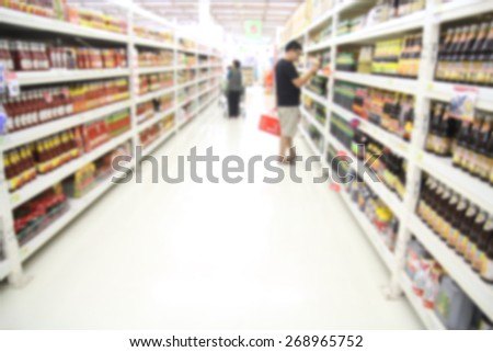 Blur supermarket background, business concept, Closeup detail of a woman shopping in a supermarket