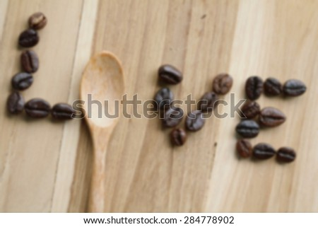 Blur The word love written with coffee beans on wood background, Vintage style - stock photo
