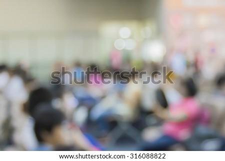 blur traveler or passenger waiting for their flight at airport terminal - stock photo