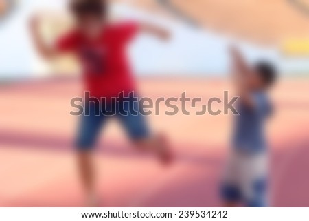 Blur Woman and boy jumps at the stadium - stock photo