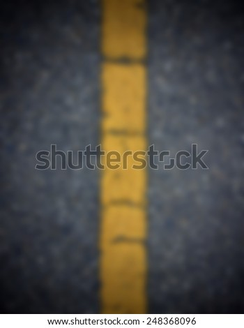 Blur yellow line sign on road - stock photo