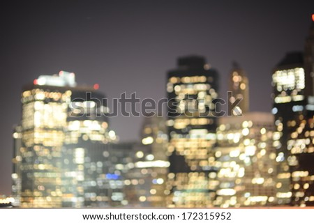 Blured background of New York skyscrapers at night - stock photo