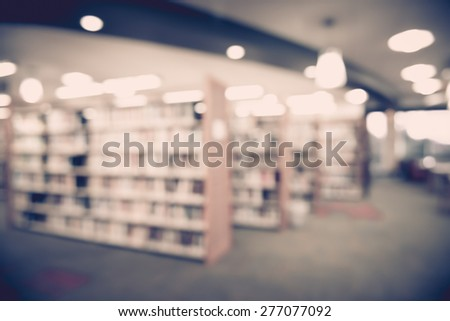 Blured books in public library. Blured effect. Background. - stock photo